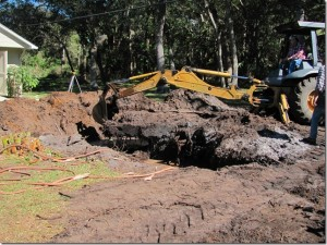 the backhoe has a reach of over 15 foot and the stump is larger